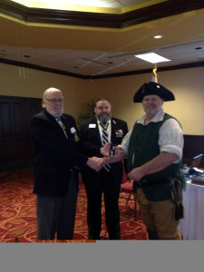Compatriot Donny Carson receives  the SAR color guard bronze and Silver medals